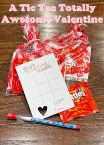 This is an image of a custom Valentine featuring a tic tac toe board, a small package of Skittles, and a pencil.